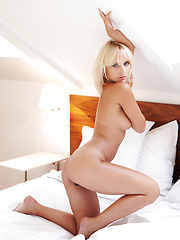 Young blonde girl Colette in erotic session
