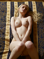 Young blonde princess posing without clothes