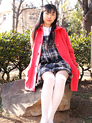 Japanese tramp poses in her school uniform as she waits