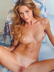 Gorgeous Cara Mell shows off her sexy body on the floor. - Erotic and nude girls pics at SoloTeenPics.com