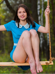 Hilary C playfully poses outdoors baring her slender body on the swing. - Erotic and nude girls pics at SoloTeenPics.com