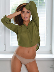 Top model Michaela Isizzu bares her trimmed pussy by the window. - Erotic and nude girls pics at SoloTeenPics.com