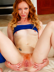 Redhead hottie teases her pussy then licks the cum from her fingers