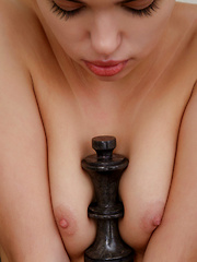 Venice Lei flaunts her slender, sexy body as she plays chess.