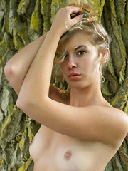 Newcomer Casey strips by the tree as she bares her nubile body.