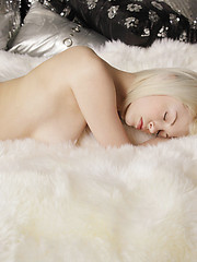 Skinny, platinum-blonde Bree strips and masturbates with her fingers and a toy