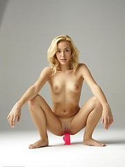 Blonde model inserting pink dildo into wet pussy