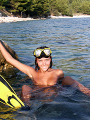 Adorable teen diver in flippers and swim mask showing off incredible nude body on the seaside. - Erotic and nude girls pics at SoloTeenPics.com