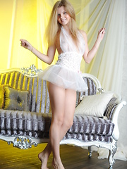 Amazing teen in tempting white lingerie showing her sweet tits and pretty pussy on sofa.