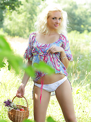 Gorgeous blonde teen chick with a basket of peaches taking off clothes outdoor on the nature. - Erotic and nude girls pics at SoloTeenPics.com
