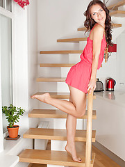 Adorable long haired teen cutie taking off clothes and posing in the nude on the stairs