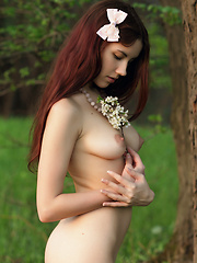 Charming teen peach with a bow in her hair undressing and showing luxurious body in a field. - Erotic and nude girls pics at SoloTeenPics.com