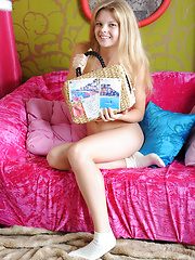 Fascinating teen hottie with excellent groomed long hair posing in white socks on pink couch.