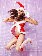 Amazing dark haired shapely teen Snow-maiden demonstrating her absolutely seductive body.