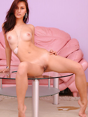 With her seductively hypnotic gaze, tempting poses showcasing her gorgeous physique all over the pink sofa, Yarina is a delightfully perfect babe. - Erotic and nude girls pics at SoloTeenPics.com