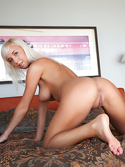 Gorgeous platinum blonde with perfect tan all over even her hairless pussy. - Erotic and nude girls pics at SoloTeenPics.com