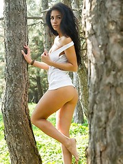 Fresh and exotic beautiful Malina relaxes amongst the lush grass and trees. - Erotic and nude girls pics at SoloTeenPics.com