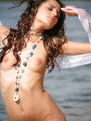Irina is radiant while laying on the beach nude and exposed with a clean shaven chastity spot. - Erotic and nude girls pics at SoloTeenPics.com