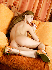 Girl posing on the couch at home - Erotic and nude girls pics at SoloTeenPics.com