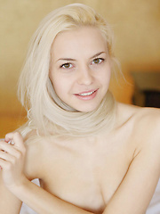 Leonie works her alluring magic as she undresses her silky smooth nightwear, moving with finesse and refinement all over the bed. - Erotic and nude girls pics at SoloTeenPics.com