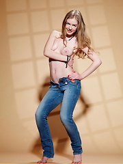 Flavia's tight, body-hugging jeans shows off her sweeping hips, round, firm rump, and her shapely legs.