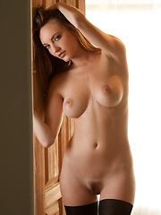 Dakota Rae - removes her top in a dim, sunlit room - Erotic and nude girls pics at SoloTeenPics.com