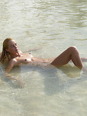 On a sunny day, Thea is relaxing by the beach, totally naked!  - Erotic and nude girls pics at SoloTeenPics.com