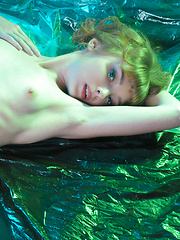 Gorgeous sweetheart like to be photographed in unusual places. For today the studio will be replaced with tent made of foil. - Erotic and nude girls pics at SoloTeenPics.com
