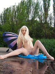 When nobody is on the lake shore, this stunning blonde takes advantage over natural beauties as her loveliness take over watchers breath.
