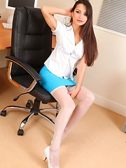 Leggy Chelsea strips on the desk in blue mini skirt - Erotic and nude girls pics at SoloTeenPics.com