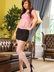 Sexy Caroline reveals pink suspenders in the study - Erotic and nude girls pics at SoloTeenPics.com