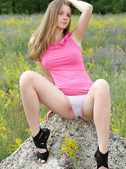 Amazing blonde teen chick tries the nude posing in a calm environment. If want to know have she enjoyed, just look at her face. - Erotic and nude girls pics at SoloTeenPics.com