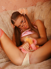 Yummy girl wearing pigtails and glasses playfully strips revealing her nice tits and pussy. - Erotic and nude girls pics at SoloTeenPics.com