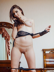 Red Fox feeling sexy and alluring in her black lace lingerie with string panty that showcases her smooth, sexy butt. - Erotic and nude girls pics at SoloTeenPics.com
