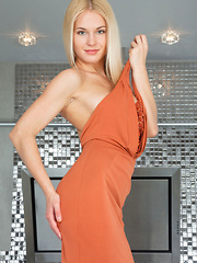 Whether dressed in a beautiful long gown that showcases her long and slender build, or absolutly naked in front of the camera, Xena's mesmerizing beauty and feminine allure is simply breathtaking