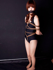Lala Asian babe in bath suit has hands tied of her boobs in ropes - Erotic and nude girls pics at SoloTeenPics.com