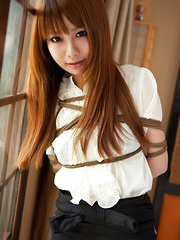 Dimdim Asian in tight office skirt and blouse is tied in ropes - Erotic and nude girls pics at SoloTeenPics.com