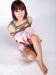 Ayako Asian leering babe has big smile on face as is tied in rope