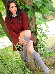 Dark haired college girl loves the outdoors and the passers by love the view of her slipping out of her uniform - Erotic and nude girls pics at SoloTeenPics.com