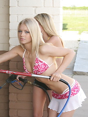 Skye and her cute petite friend show off in skimpy bikinis at the car wash - Erotic and nude girls pics at SoloTeenPics.com