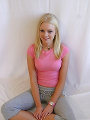 Super cute Skye poses for pictures in a tight pink shirt and grey sweat capris - Erotic and nude girls pics at SoloTeenPics.com