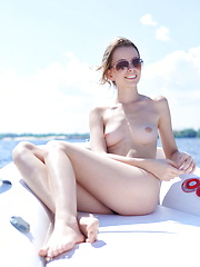 Lucia D sunbathes nude on a boat - Erotic and nude girls pics at SoloTeenPics.com