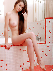 Emily Bloom plays naked in the bath tub - Erotic and nude girls pics at SoloTeenPics.com