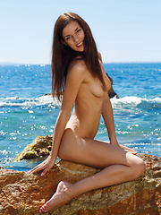 Candice Luka strips off her black bikini and basks naked under the sun - Erotic and nude girls pics at SoloTeenPics.com