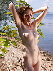 Captivating girl on seashore - Erotic and nude girls pics at SoloTeenPics.com