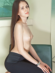 An alluring Margo G flaunts her nude chest under her khaki jacket before slowing slipping it off and teasing her butt out of her tight black pants to reveal her perfect little pussy.