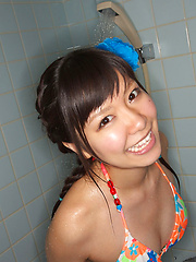 Sweet Ayana Tanigaki smiles and poses at the kitchen with banana - Erotic and nude girls pics at SoloTeenPics.com