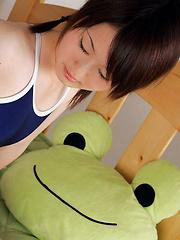 Naoko Sawano Asian in bath suit puts pillow between her sexy legs - Erotic and nude girls pics at SoloTeenPics.com
