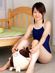 Naoko Sawano Asian in bath suit puts pillow between her sexy legs - Erotic and nude girls pics at SoloTeenPics.com