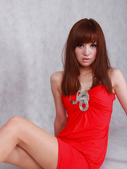 Sandy Asian in red dress is so leering touching her sexy lips - Erotic and nude girls pics at SoloTeenPics.com